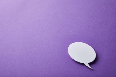 white speech bubble card on purple surface