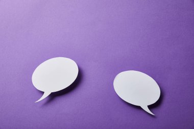 white speech bubbles cards on purple surface