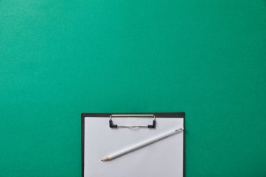 Top view of pencil on folder with blank paper isolated on green stock vector