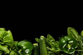 top view of fresh organic green vegetables isolated on black