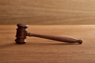 wooden gavel on brown wooden table with copy space