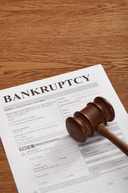 bankruptcy form under wooden gavel on brown wooden table