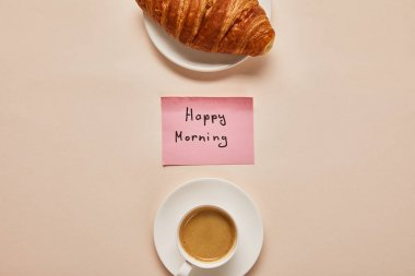 Flat lay with coffee, croissant and sticky note with happy morning lettering on beige background stock vector