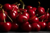selective focus of red delicious and ripe cherries
