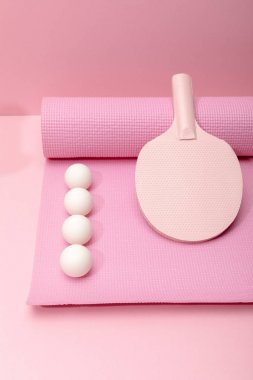 Flat lay with white ping-pong balls and racket on fitness mat on pink background stock vector