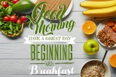 top view of fresh fruits, vegetables and cereal on wooden white background with good morning, have a great day beginning with breakfast lettering
