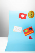 Photo colorful paper icons on blue background, finance concept