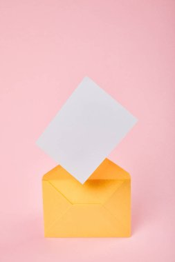 Yellow envelope with blank white card on pink background stock vector