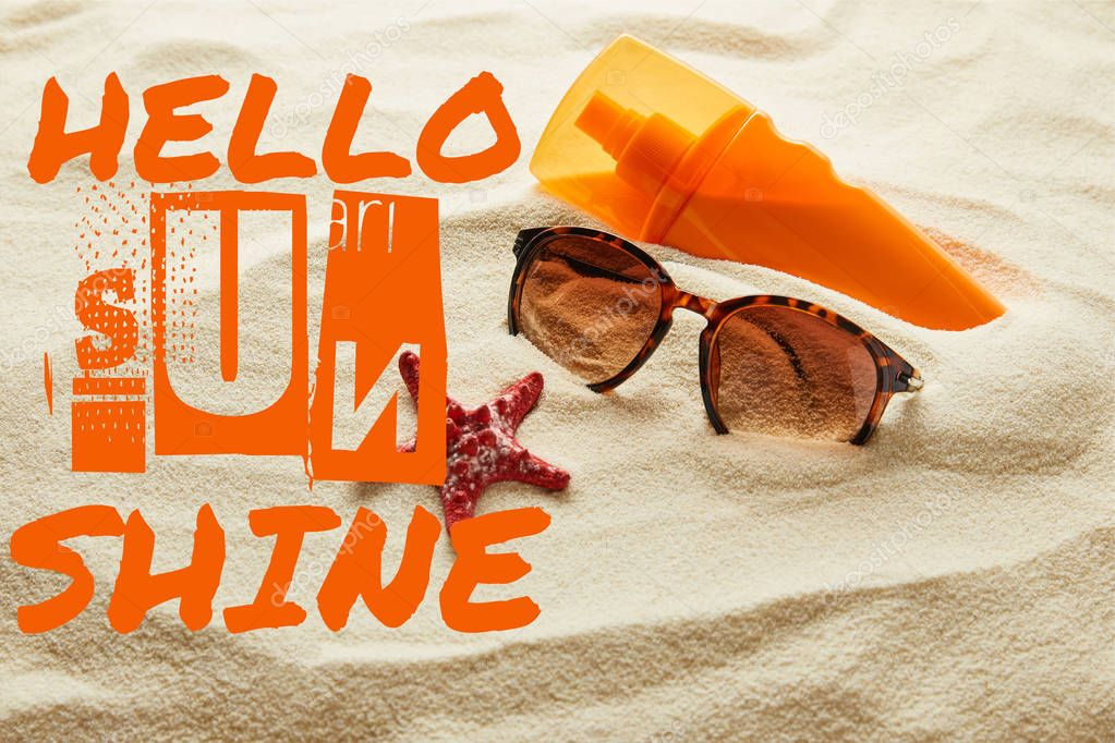 Brown stylish sunglasses and sunscreen in orange bottle on sand with hello sunshine lettering stock vector