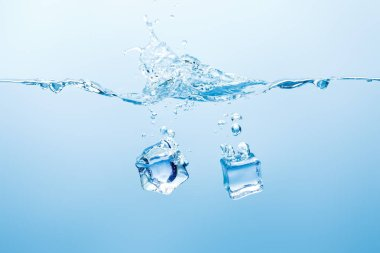 Pure water with splash and ice cubes on blue background stock vector