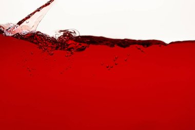 Flowing red liquid with splash and bubbles isolated on white stock vector