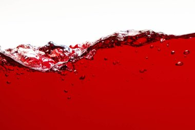 Red bright liquid with splash and bubbles isolated on white stock vector