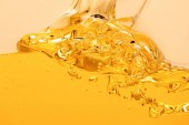yellow bright liquid splash with bubbles isolated on yellow