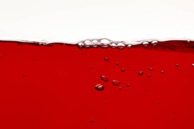 Red bright liquid with bubbles on surface isolated on white stock vector
