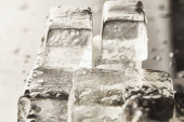Photo close up view of transparent wet textured ice cubes