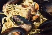 close up view of delicious Italian pasta with mollusks and mussels