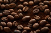 Fotografie Roasted coffee grains mixed with ground coffee