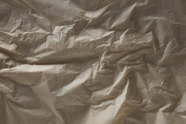 top view of beige wrinkled parchment paper surface with copy space