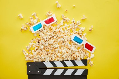 Top view of delicious popcorn, 3d glasses and clapper board on yellow background stock vector