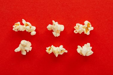 Flat lay with sweet popcorn on red background stock vector
