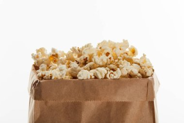 Delicious popcorn in paper bag isolated on white stock vector