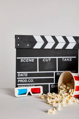 Delicious popcorn with clapper board and 3d glasses isolated on grey stock vector