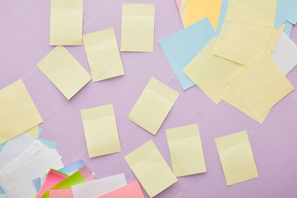 Top view of colorful sticky notes isolated on purple