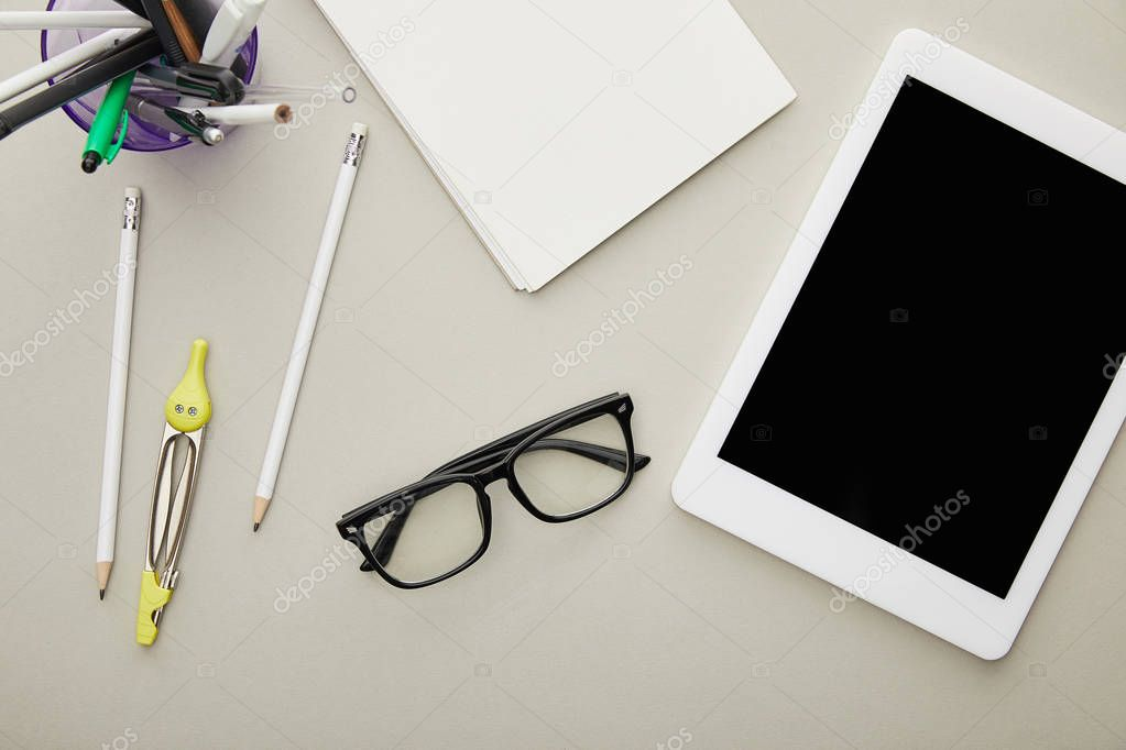 Top view of digital tablet with blank screen near stationery and glasses isolated on grey stock vector