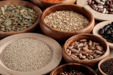 wooden bowls with beans, quinoa, pumpkin seeds and oatmeal