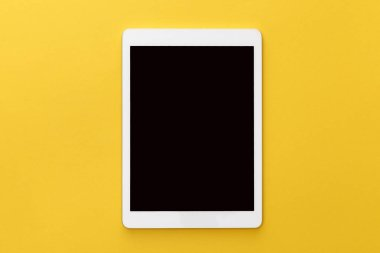 Top view of digital tablet with blank screen on yellow background stock vector