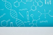 Photo blue background with molecular structure signs near white surface