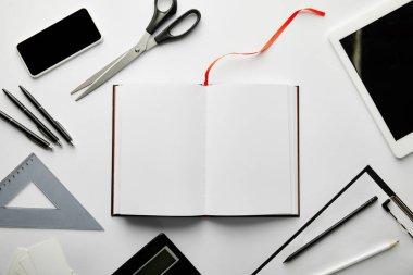 Top view of clipboard, notebook, pens, pencils, scissors, triangle ruler, calculator, smartphone and digital tablet stock vector