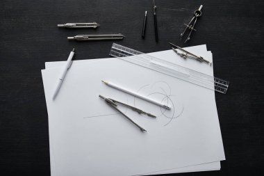top view of paper with copy space, pencil, pen, ruler and compasses