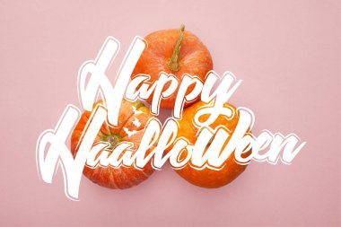 top view of pumpkin on pink background with happy Halloween illustration, Halloween decoration