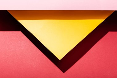 Top view of empty yellow and pink paper sheets on crimson stock vector