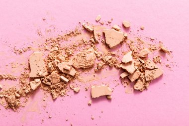 Top view of beige and cracked face powder on pink stock vector
