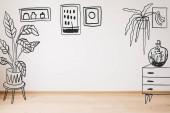 kreslený prádelník, rostliny a malby na stěně a dřevěné podlaze