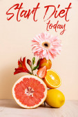 floral and fruit composition with citrus fruits, strawberry and peach near start diet today lettering on beige