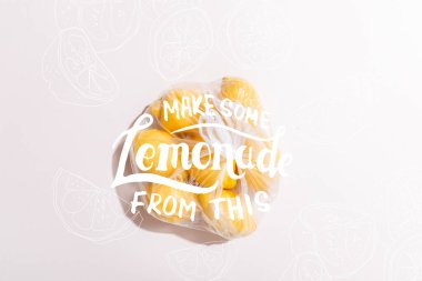 Top view of yellow lemons in package on grey table with make some lemonade from this lettering stock vector