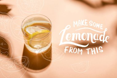 Glass of fresh water with lemon slices on beige with make some lemonade from this lettering stock vector