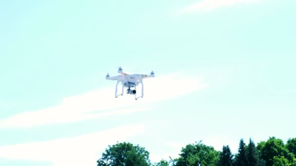 Drone flying in the sky, quadrocopter with a camera flies in the air