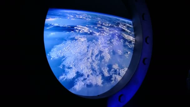 View of the Earth through the porthole of spaceship. International space station