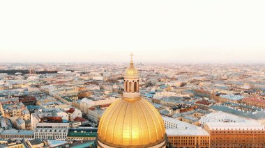 Drone flies to the dome of St. Isaacs Cathedral in the historical center of St. Petersburg at sunset