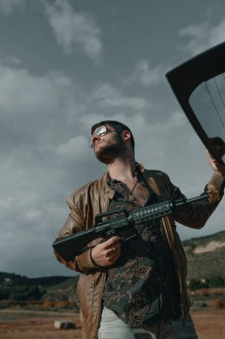 Man with a gun. Man with assault rifle. Man with machine gun.