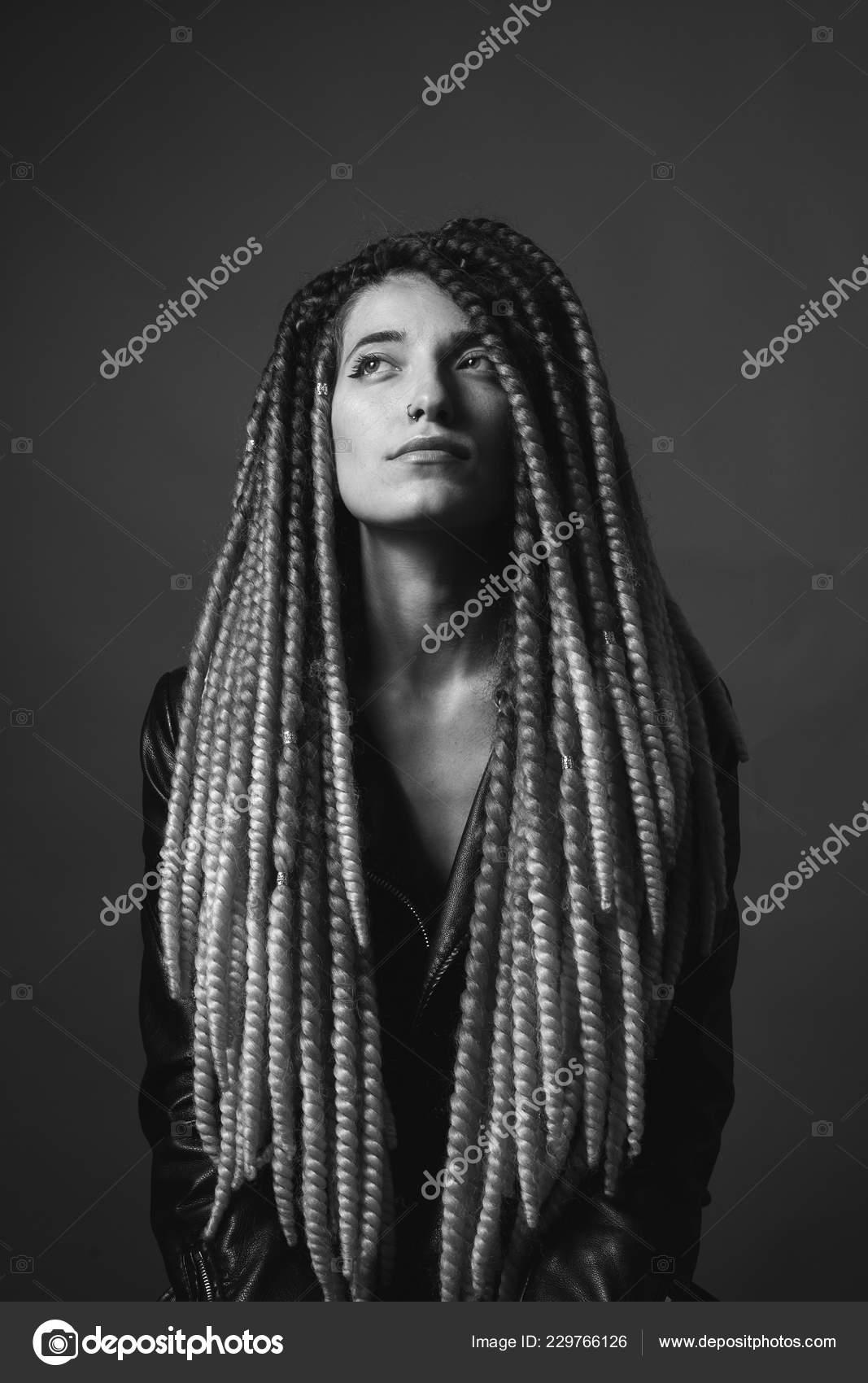 Unusual beautiful woman studio braids black white stock photo