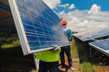 engineer team working on replacement solar panel in solar power plant;engineer and electrician team swapping and install solar panel ; electrician team checking hot spot on break pane
