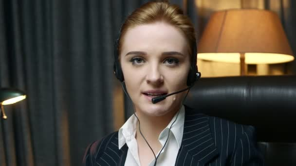 Call center operator answers the call and communicates with the client. Front view.