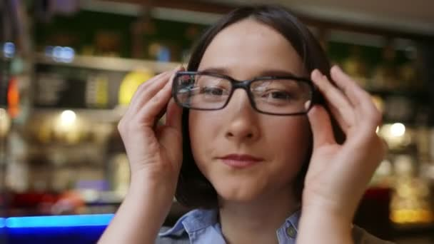 Attractive young businesswoman wearing glasses