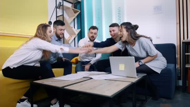 Successful team in office: many hands holding together and then gives five each other.