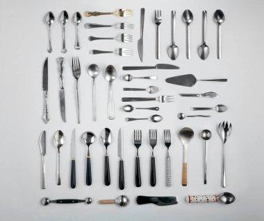 Closeup of luxury cutlery set on grey background